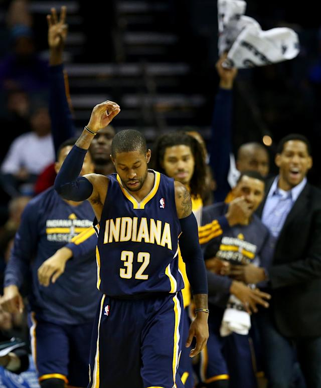 CHARLOTTE, NC - NOVEMBER 27: C.J. Watson #32 of the Indiana Pacers reacts after making a basket against the Charlotte Bobcats during their game at Time Warner Cable Arena on November 27, 2013 in Charlotte, North Carolina. (Photo by Streeter Lecka/Getty Images)