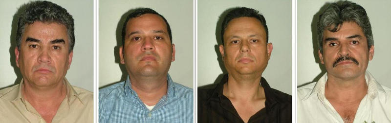 "In this photo released by the Spanish Interior Ministry on Friday Aug. 10, 2012 four suspected members of a Mexican drug cartel are seen in this hand out photo. Left to right, Jesus Gutierrez Guzman, Samuel Zazueta, Rafael Humberto Celaya Valenzuela, and Jesus Gonzalo Palazuelos Soto. The Interior Ministry said Friday Aug. 10, 2012 Spanish police working in a joint investigation with the FBI's Boston Division have halted an attempt by a major Mexican drug smuggling ring to establish a European operation. Four alleged members of the Sinaloa cartel, including Jesus Gutierrez Guzman, a cousin of ""the biggest drug trafficker in the world,"" Joaquín Archivaldo Guzman Loera known as ""El Chapo"" have been arrested in Madrid a statement says. The statement Friday said Spain was to have been used by the cartel as a gateway for drug importation and distribution throughout Europe but investigators intercepted a container carrying 373 kilos (822 pounds) of cocaine in July, leading to the arrests. (AP Photo/ Spanish Interior Ministry)"