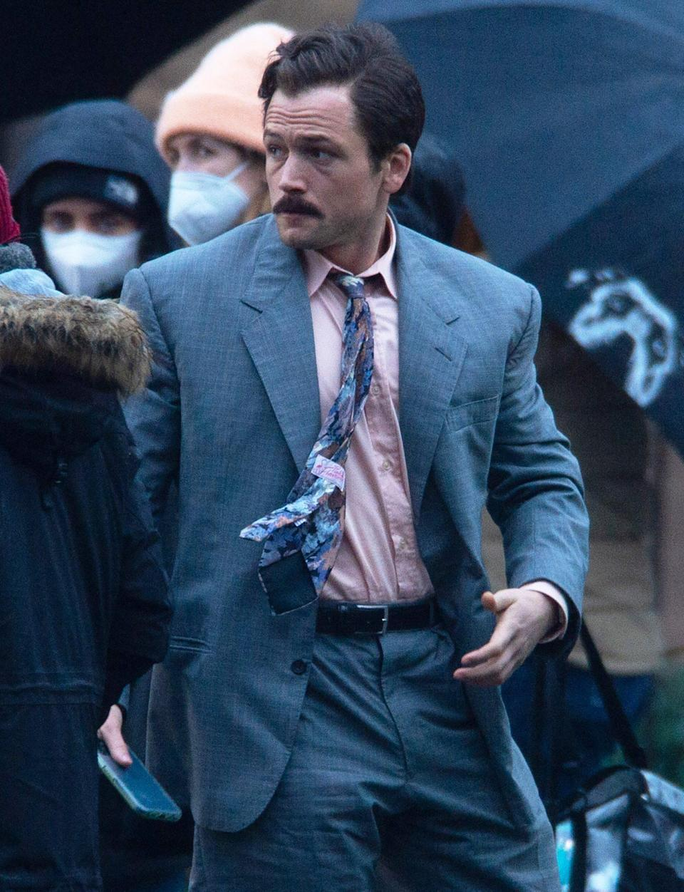 <p>Taron Egerton films scenes for his upcoming movie <em>Tetris</em> in Glasgow, Scotland, on Friday.</p>