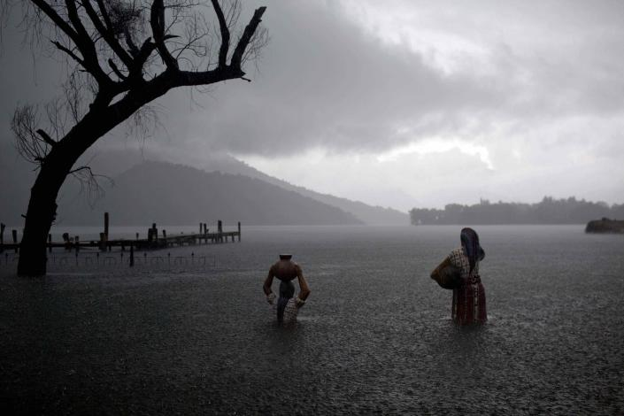 Sculptures of Mayan women are partially submerged in floodwaters in Santiago Atitlan, Guatemala, Friday Sept. 9, 2011. Guatemalans appear poised to elect former general Otto Perez Molina of the Patriotic Party as president in Sunday's election. Molina is not likely to win outright. Candidates must get more than 50 percent of the vote to avoid a November runoff, and recent polls show Perez with 40 percent in a field of 10 candidates.