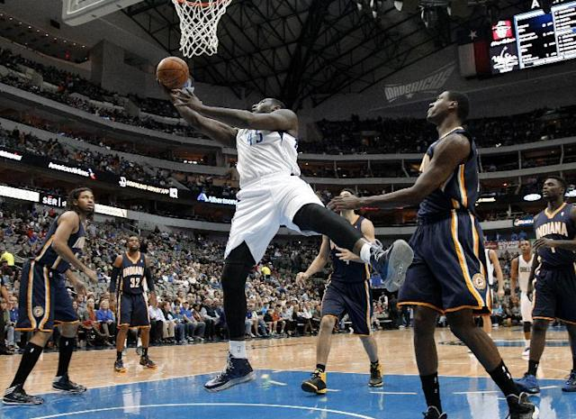 Dallas Mavericks' DeJuan Blair (45) goes up for a shot against Indiana Pacers', from left, Chris Copeland, C.J. Watson (32), Luis Scola, rear, Ian Mahinmi, of France, and Lance Stephenson, right, in the first half of a preseason NBA basketball game, Friday, Oct. 25, 2013, in Dallas. (AP Photo/Tony Gutierrez)