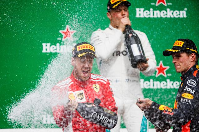 Well, glad that's over: Vettel, Bottas and Verstappen celebrate the end of a dull Canadian Grand Prix