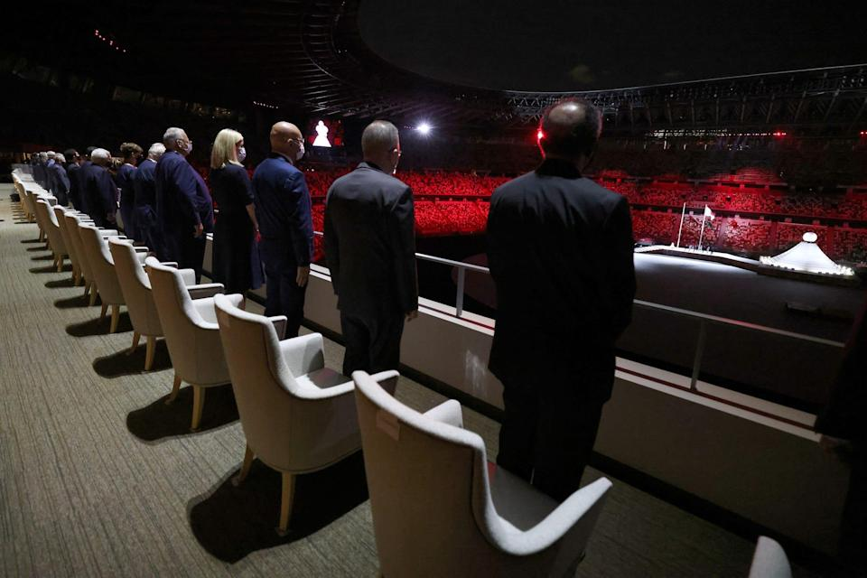 VIP officials look on during the opening ceremony.
