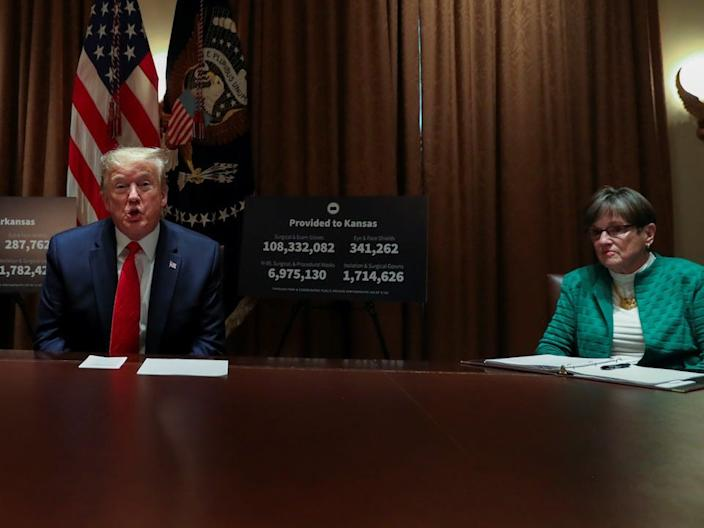 President Donald Trump and Gov. Kelly in the White House Cabinet Room on May 20, 2020.
