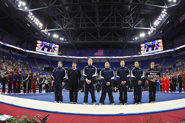 ST. LOUIS, MO - JUNE 7: Members of the Penn State team observe the National Anthem prior to competing in the Senior Men's competition on day one of the Visa Championships at Chaifetz Arena on June 7, 2012 in St. Louis, Missouri. (Photo by Dilip Vishwanat/Getty Images)