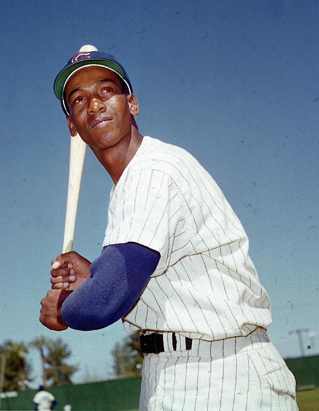 FILE - In this 1970 file photo, Chicago Cubs' Ernie Banks poses with a baseball bat. The Cubs announced Friday night, Jan. 23, 2015, that Banks had died. The team did not provide any further details. Banks was 83. (AP Photo/File)