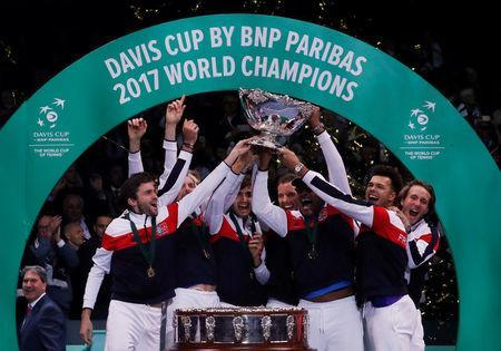 Tennis - Davis Cup Final - France vs Belgium - Stade Pierre Mauroy, Lille, France - November 26, 2017 France team celebrate with the trophy after winning the Davis Cup Final REUTERS/Yves Herman