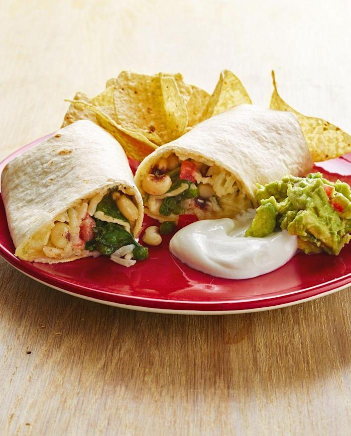 """<p>Choose your favorite toppings to pair with these hearty veggie burritos, like sour cream, guacamole, and pico de gallo.</p><p><strong><a href=""""https://www.thepioneerwoman.com/food-cooking/recipes/a32392833/veggie-burritos-with-black-eyed-peas-recipe/"""" rel=""""nofollow noopener"""" target=""""_blank"""" data-ylk=""""slk:Get the recipe."""" class=""""link rapid-noclick-resp"""">Get the recipe.</a></strong> </p>"""