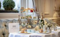 """<p>Celebrating the best of the capital, <a href=""""https://go.redirectingat.com?id=127X1599956&url=https%3A%2F%2Fwww.booking.com%2Fhotel%2Fgb%2Fthe-kensington-london.en-gb.html%3Faid%3D2070929%26label%3Dhotel-afternoon-tea&sref=https%3A%2F%2Fwww.redonline.co.uk%2Ftravel%2Fg37102406%2Fhotel-afternoon-tea%2F"""" rel=""""nofollow noopener"""" target=""""_blank"""" data-ylk=""""slk:The Kensington"""" class=""""link rapid-noclick-resp"""">The Kensington</a>'s London Landmarks Afternoon Tea takes in inspiration from London's most recognisable and historic sites. For this hotel afternoon tea, you'll go on a gourmet tour of London's architectural feats from the opulent surroundings of the Drawing Room, complete with open log fires and sumptuous seating. </p><p>The afternoon tea is presented on a London Eye-inspired tea stand, served with a map of London illustrated by Eleni Sofroniou. Starting with a skyline of scones and sandwiches, you can then enjoy cockney staple Steak & London Ale Pie and a Colston Bassett Stilton & Broccoli Quiche. For dessert, 'The Gherkin' is crafted from white chocolate and dark chocolate ganache and 'The Shard' is made of carrot cake and milk chocolate.</p><p><strong>Price:</strong> From £42 per person</p><p><a class=""""link rapid-noclick-resp"""" href=""""https://go.redirectingat.com?id=127X1599956&url=https%3A%2F%2Fwww.booking.com%2Fhotel%2Fgb%2Fthe-kensington-london.en-gb.html%3Faid%3D2070929%26label%3Dhotel-afternoon-tea&sref=https%3A%2F%2Fwww.redonline.co.uk%2Ftravel%2Fg37102406%2Fhotel-afternoon-tea%2F"""" rel=""""nofollow noopener"""" target=""""_blank"""" data-ylk=""""slk:BOOK A ROOM"""">BOOK A ROOM</a><br></p>"""