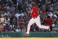 Boston Red Sox's J.D. Martinez scores on a double by Kevin Plawecki as New York Yankees' Rob Brantly, left, looks for a throw during the second inning of a baseball game, Saturday, July 24, 2021, in Boston. (AP Photo/Michael Dwyer)