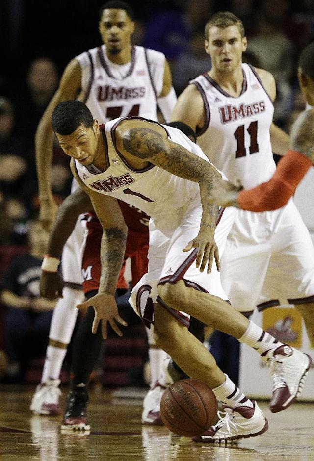 Massachusetts forward Maxie Esho (1) chases down a loose ball during the first half of an NCAA college basketball game against Miami (Ohio) in Amherst, Mass., Saturday, Jan. 4, 2014. (AP Photo/Stephan Savoia)