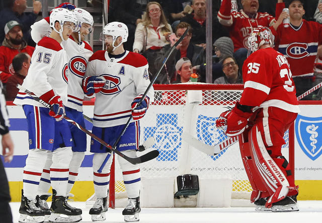 Montreal Canadiens right wing Joel Armia, second from left, celebrates his goal against the Detroit Red Wings in the second period of an NHL hockey game, Tuesday, Feb. 26, 2019, in Detroit. (AP Photo/Paul Sancya)