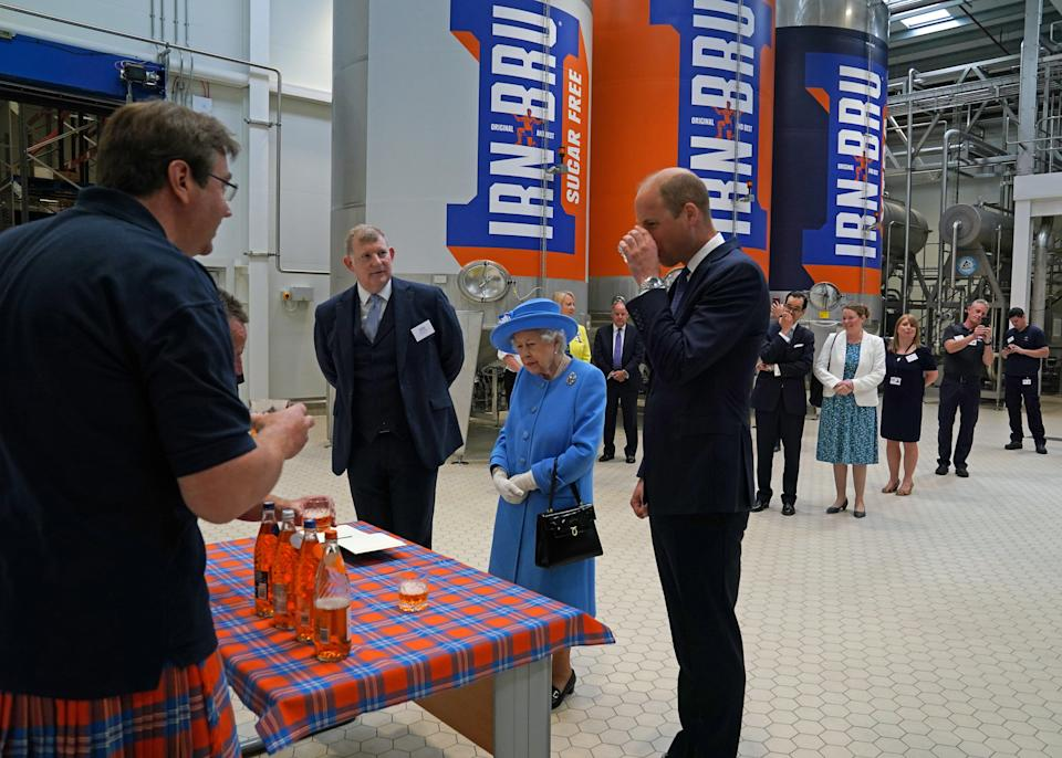 The Queen is introduced to the drink (PA Wire)