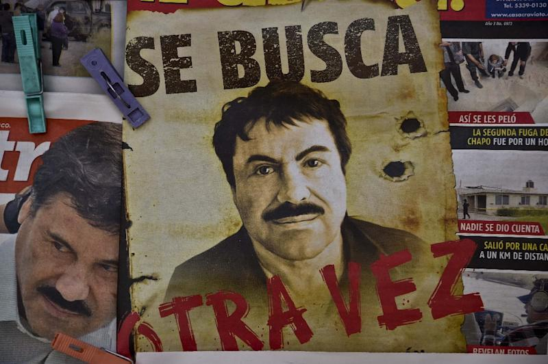 "A poster with the face of Mexican drug lord Joaquin ""El Chapo"" Guzman at a news stand in a Mexico City bus terminal on July 13, 2015"