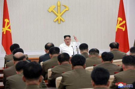 North Korean leader Kim Jong Un speaks during The first enlarged meeting of the seventh Central Military Commission of the Workers' Party of Korea (WPK), in this undated photo released by North Korea's Korean Central News Agency (KCNA) in Pyongyang May 18, 2018. KCNA/via REUTERS
