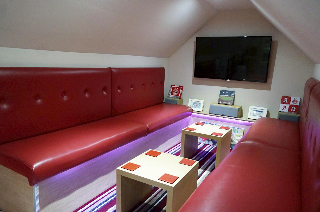 <p>Graeme Strachan created the impressive games room and bar as a shrine to his beloved Aberdeen FC in the loft of his Scottish home. </p>