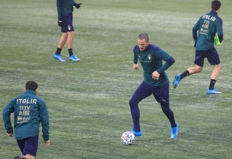Italy's players including Leonardo Bonucci (C) train prior to the World Cup qualifier against Lithuania in Vilnius