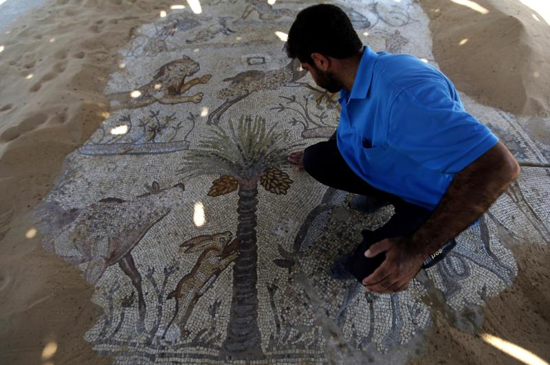 A man looks at a mosaic at St. Hilarion's monastery in the Jabaliya refugee camp, northern Gaza Strip, in a Tuesday, Aug. 6, 2013 photo. St. Hilarion's monastery, a reminder of the time in late antiquity when Christianity was the dominant faith in what is now the Gaza Strip, is one of many archaeological treasures scattered across this coastal territory. (AP photo/Hatem Moussa)