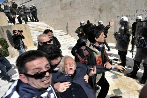 In 2012, Glezos was tear-gassed by riot police during an anti-austerity protest