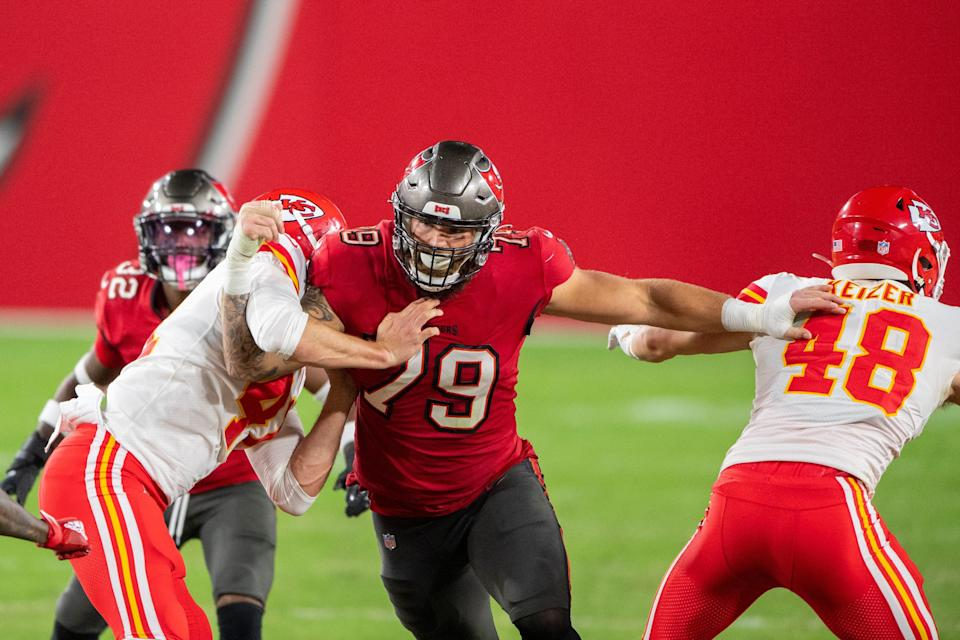 Tampa Bay Buccaneers defensive lineman Patrick O'Connor (79) in action against Kansas City Chiefs long snapper James Winchester (41) and Kansas City Chiefs tight end Nick Keizer (48) during their match-up in November.