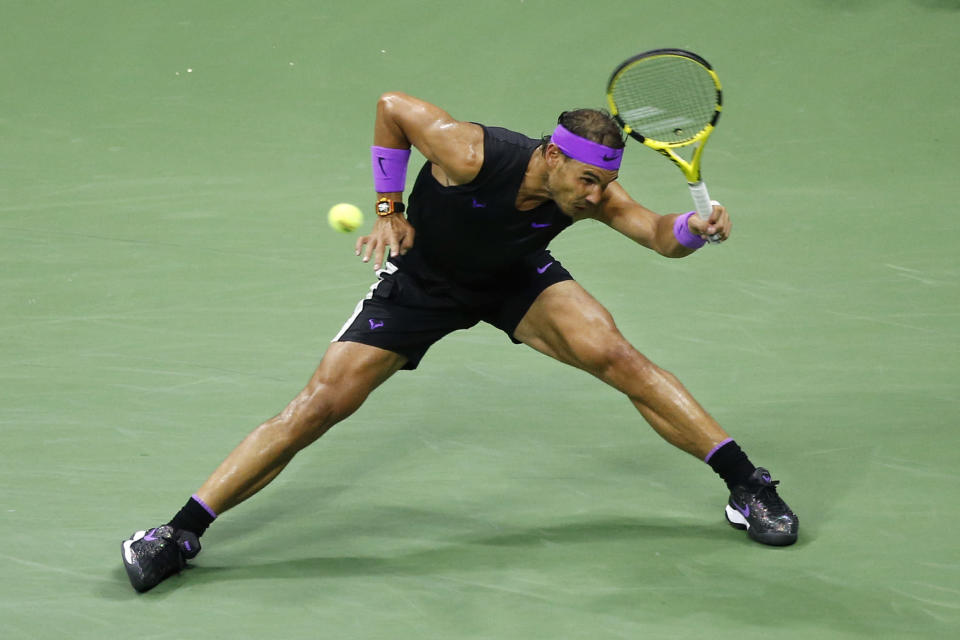 Rafael Nadal, of Spain, returns a shot to Marin Cilic, of Croatia, during the fourth round of the U.S. Open tennis tournament Monday, Sept. 2, 2019, in New York. (AP Photo/Jason DeCrow)