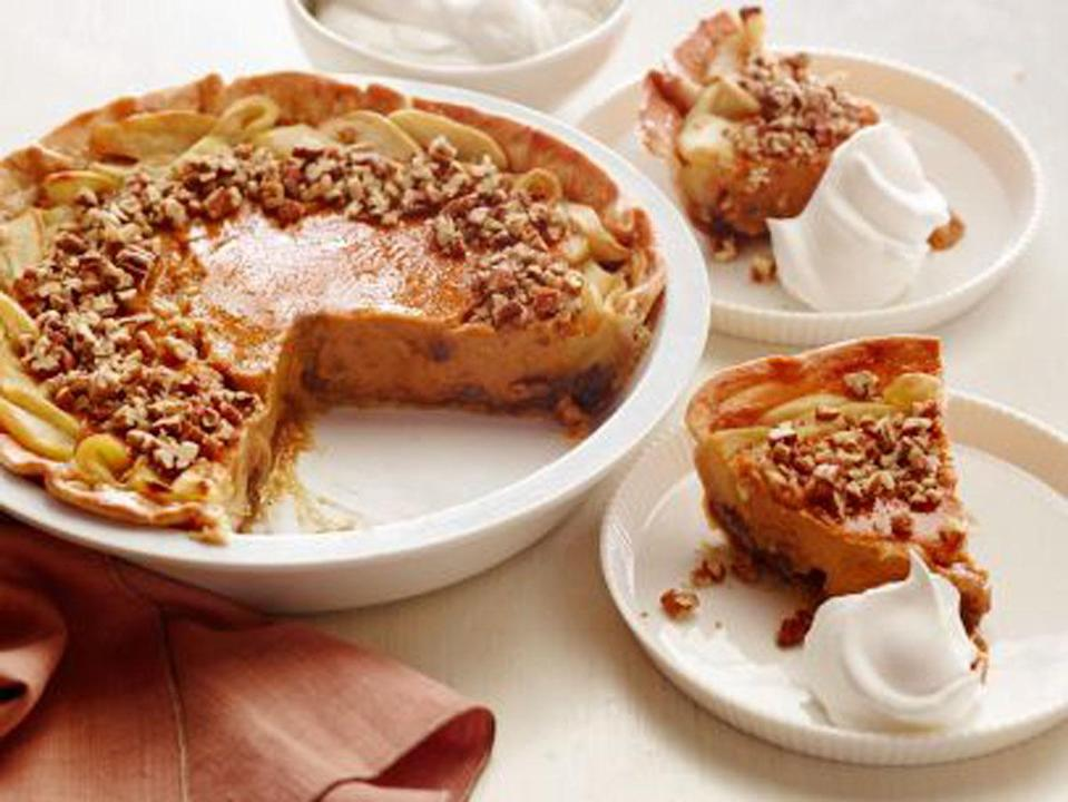 """<p>It's the Thanksgiving pie triple whammy: apple, pumpkin, <i>and</i> pecan. The combo yields a gooey pecan bottom, sweet-and-tart apple edge, and creamy pumpkin center. <a href=""""http://www.foodnetwork.com/recipes/food-network-kitchens/apple-pumpkin-pecan-pie.html?oc=PTNR-YahooFood-thanksgiving_on_yahoo"""" rel=""""nofollow noopener"""" target=""""_blank"""" data-ylk=""""slk:Get Food Network's Apple-Pumpkin-Pecan Pie here."""" class=""""link rapid-noclick-resp""""><b>Get Food Network's Apple-Pumpkin-Pecan Pie here</b>. </a>(<i>Photo: Food Network)</i></p>"""