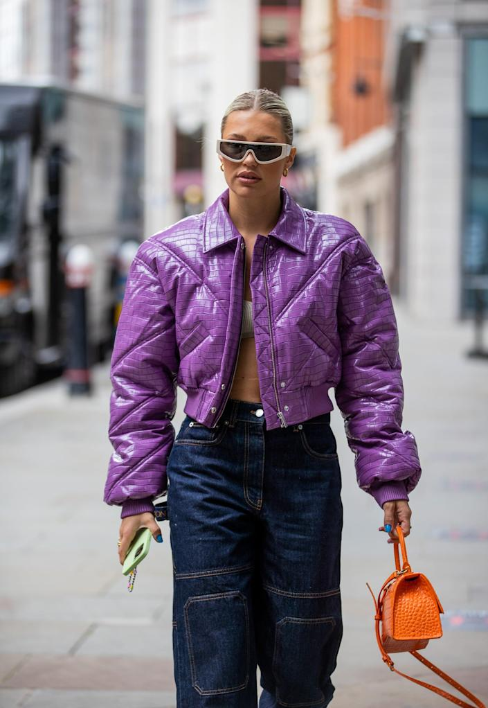 <p>Finishing off denim with a saturated lavender puffer and an orange bag in tow really amps up the look, no? </p>