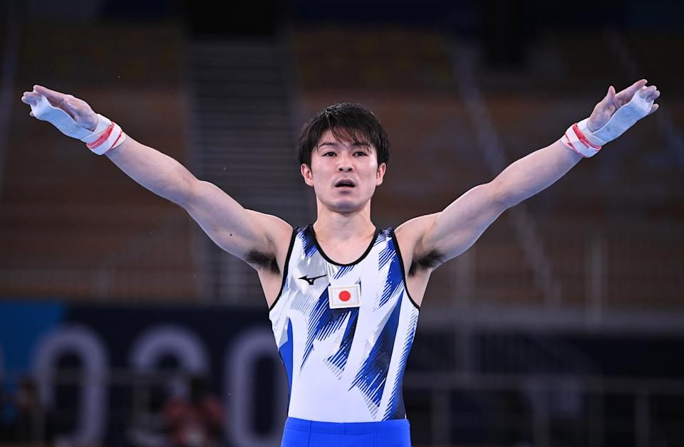 Kohei Uchimura of Japan pictured after competing on — and slipping from — the horizontal bar. He, like Simone Biles, is frequently referred to as the