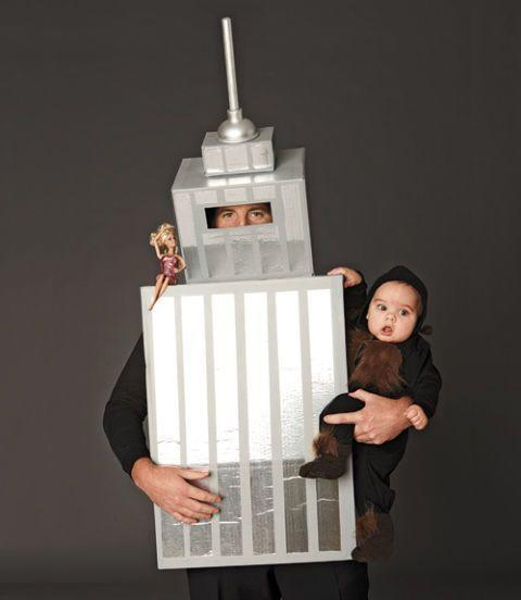 """<p>Even if you don't have a real-life baby monkey, carrying around a stuffed monkey works just as well for this clever King Kong costume.</p><p><strong><em><a href=""""https://www.womansday.com/home/crafts-projects/how-to/a6014/diy-halloween-costume-king-kong-123703/"""" rel=""""nofollow noopener"""" target=""""_blank"""" data-ylk=""""slk:Get the Empire State Building tutorial"""" class=""""link rapid-noclick-resp"""">Get the Empire State Building tutorial</a>. </em></strong> </p>"""