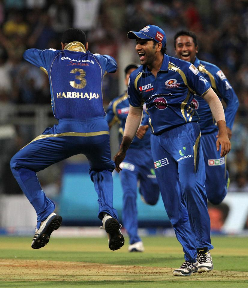 Mumbai Indian player Harbhajan Singh celebrates with his teammates after getting the wicket of Royal Challengers Bangalore player Chris Gayle during match 37 of the Pepsi Indian Premier League ( IPL) 2013  between The Mumbai Indians and the Royal Challengers Bangalore held at the Wankhede Stadium in Mumbai on the 27th April 2013. (BCCI)