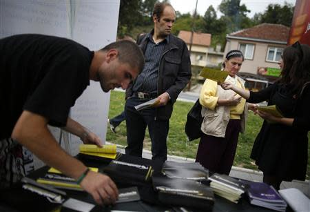 Volunteers hand out leaflets with information about new Bosnia's census in Jablanica