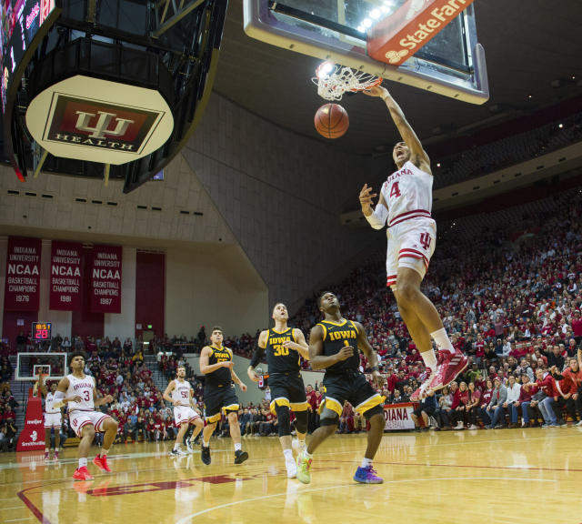 Indiana forward Trayce Jackson-Davis (4) scores with a slam dunk during the first half of an NCAA college basketball game against Iowa, Thursday, Feb. 13, 2020, in Bloomington, Ind. (AP Photo/Doug McSchooler)