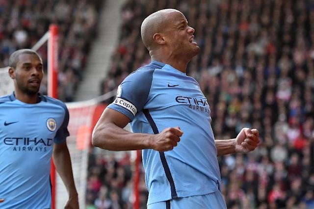 Manchester City's defender Vincent Kompany celebrates after scoring the opening goal of the English Premier League football match between Southampton and Manchester City at St Mary's Stadium in Southampton, southern England on April 15, 2017 (AFP Photo/Glyn KIRK)