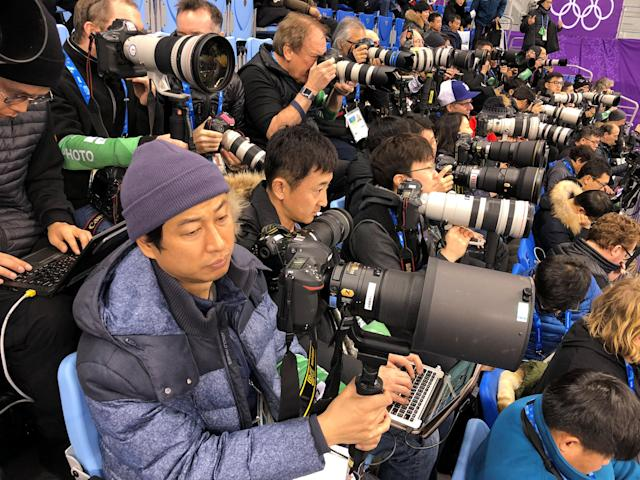 Short Track Speed Skating Events – Pyeongchang 2018 Winter Olympics – Women's 500m Semifinal – Gangneung Ice Arena - Gangneung, South Korea – February 13, 2018 - Photographers wait for the start of the race. REUTERS/Lucy Nicholson
