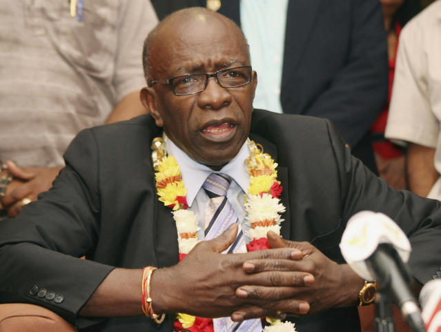 FILE - In this June 2, 2011, file photo, suspended FIFA executive Jack Warner gestures during a news conference at the airport in Port-of-Spain, Trinidad and Tobago. According to documents Saturday June 13, 2020, former FIFA president Sepp Blatter is the target of a new investigation for suspected criminal mismanagement of soccer funds, the latest allegation linking FIFA to irregular payments benefiting Jack Warner, its former vice president from Trinidad. (AP Photo/Shirley Bahadur, File)