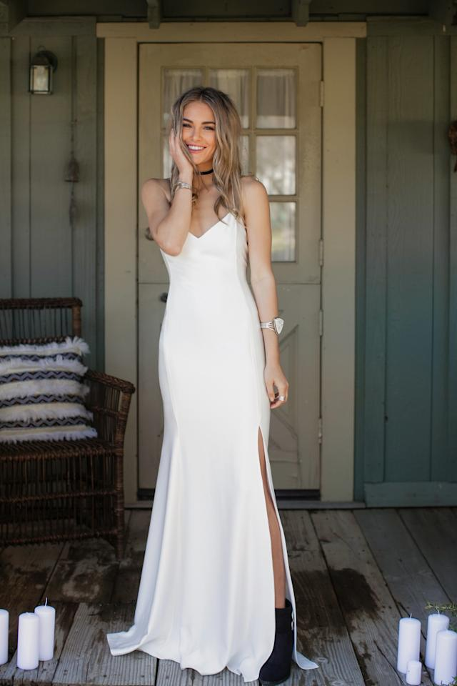 """<p><b>MORE:</b> <strong><a rel=""""nofollow"""" href=""""http://www.brides.com/story/wedding-horoscope-love-astrology?mbid=synd_yahoolife"""">What Your Zodiac Sign Says About Your Marriage</a></strong></p><p>A satin crêpe, spaghetti strap dress with a minimalist silhouette and sultry slit.</p>"""