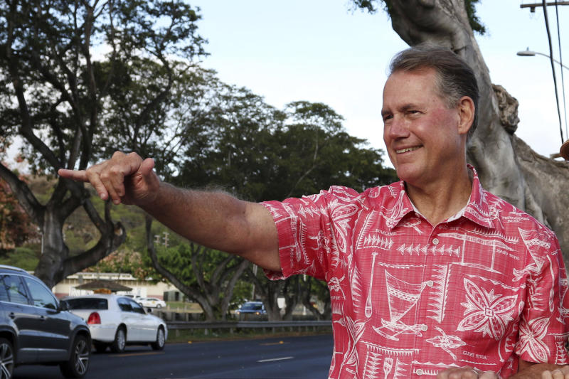 FILE - In this July 24, 2018, file photo, former U.S. Rep. Ed Case greets evening commuters while campaigning for the U.S. congressional seat representing urban Honolulu, in Honolulu. Hawaii voters head to the polls this weekend for a primary election that will most likely settle the outcome of this year's major races. That's because the Democratic Party continues to overwhelmingly dominate Hawaii politics. (AP Photo/Audrey McAvoy, File)