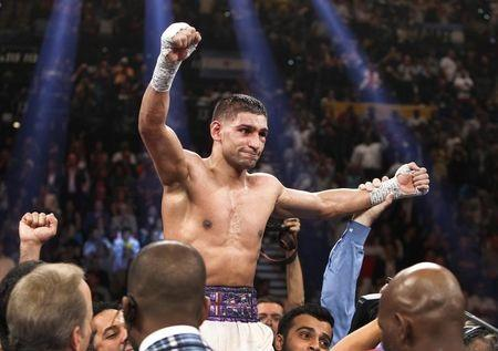 Amir Khan of Britain celebrates his victory over Luis Collazo of the U.S. after their welterweight fight at the MGM Grand Garden Arena in Las Vegas