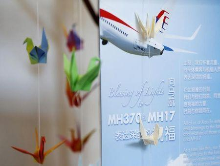 A memorial to the victims of both flights MH370 and MH17 is set up at the Xiao En Bereavement Centre in Kuala Lumpur