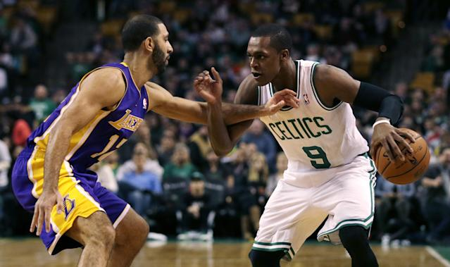 Boston Celtics guard Rajon Rondo (9) tries to drive past Los Angeles Lakers point guard Kendall Marshall, left, during the first quarter of an NBA basketball game in Boston, Friday, Jan. 17, 2014. Rondo returned to the court for the first time this season, after undergoing surgery on his right knee. (AP Photo/Charles Krupa)
