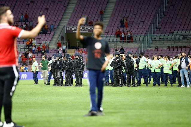 Soccer Football - International Friendly - Tunisia vs Turkey - Stade de Geneve, Geneva, Switzerland - June 1, 2018 Police and stewards on the pitch REUTERS/Denis Balibouse