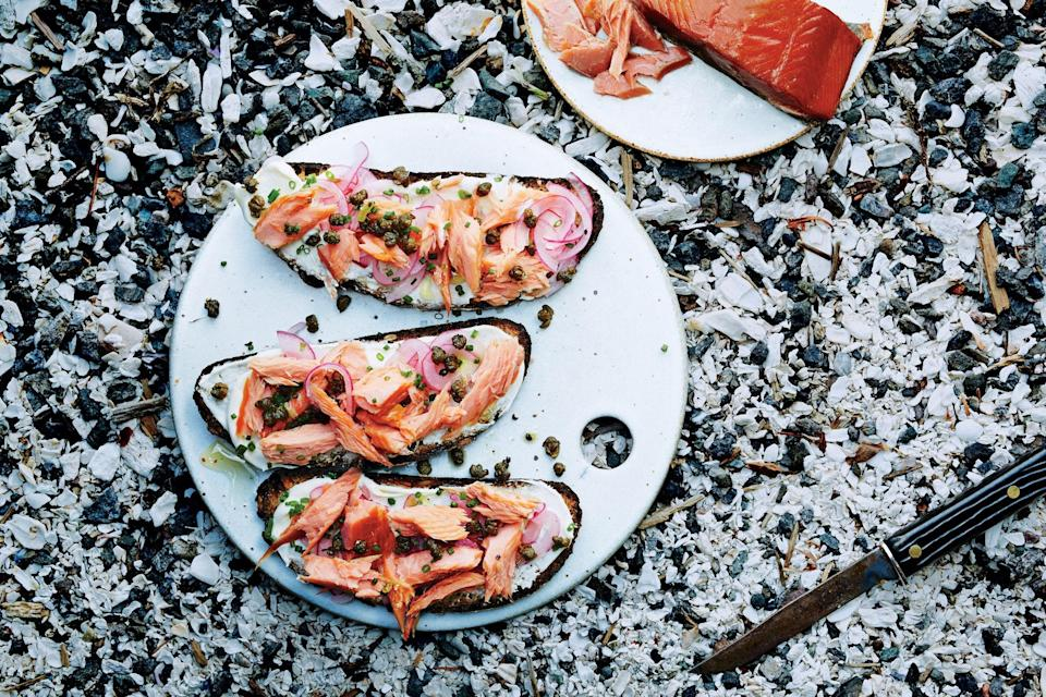 "Flaky hot-smoked salmon adds savory smoke to these crème fraîche-slathered toasts. Fried capers on top really make the dish restaurant-worthy, but we promise, it's easy to make at home. <a href=""https://www.epicurious.com/recipes/food/views/smoked-salmon-tartines-with-fried-capers-51235900?mbid=synd_yahoo_rss"" rel=""nofollow noopener"" target=""_blank"" data-ylk=""slk:See recipe."" class=""link rapid-noclick-resp"">See recipe.</a>"