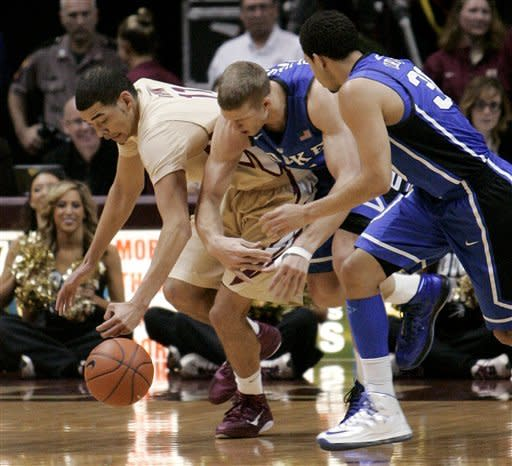 Florida State's Kiel Turpin fights for a loose ball with Duke's Mason Plumlee, center, and Seth Curry during the first half of an NCAA college basketball game Saturday, Feb. 2, 2013, in Tallahassee, Fla. Duke won 79-60. (AP Photo/Steve Cannon)