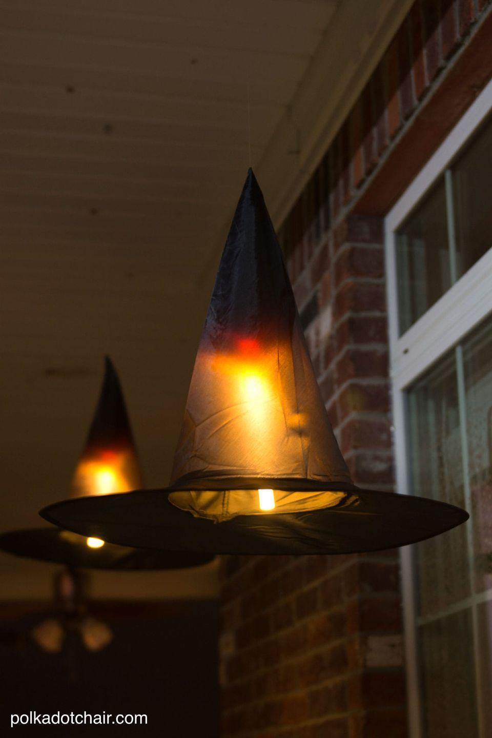 "<p>Add some magic to the top half of your porch with these hanging witch hat lanterns. Getting the hats to levitate is as simple as tying them with fishing line. </p><p><a href=""https://www.polkadotchair.com/floating-witch-hat-luminaries/"" rel=""nofollow noopener"" target=""_blank"" data-ylk=""slk:Get the tutorial at Polkadot Chair »"" class=""link rapid-noclick-resp""><em>Get the tutorial at Polkadot Chair »</em></a></p>"