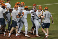Texas players celebrate their win over South Florida in an NCAA Super Regional college baseball game, Sunday, June 13, 2021, in Austin, Texas. (AP Photo/Eric Gay)