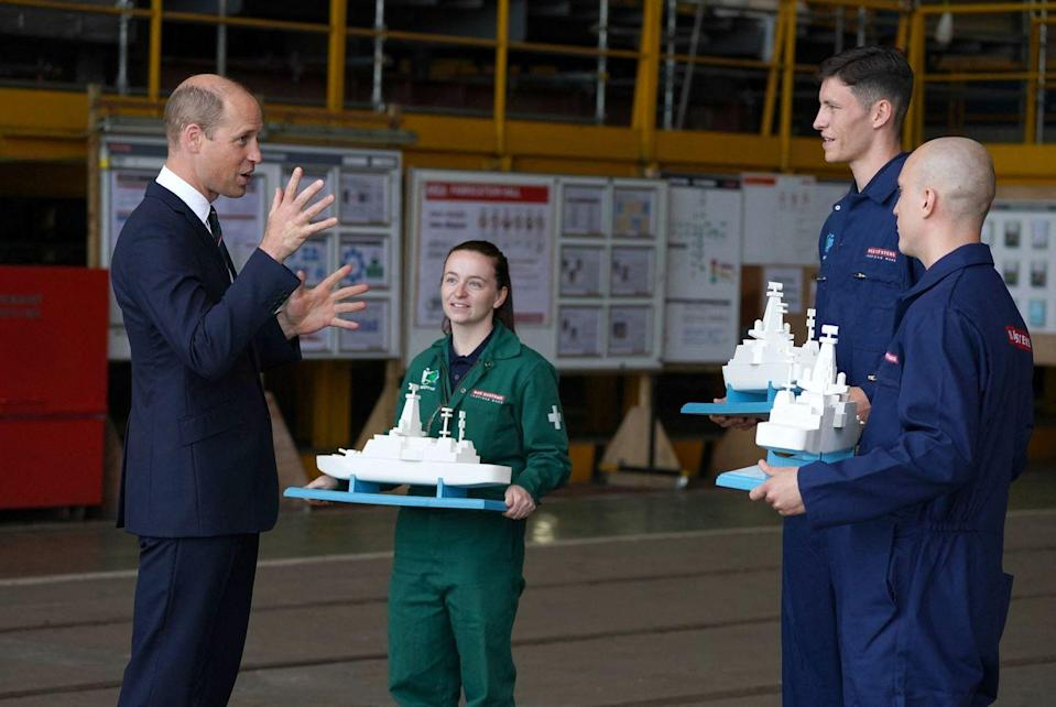 <p>Prince William receives Royal Navy warship models as a parting gift after his speech at the steel cutting ceremony for HMS Belfast.</p>
