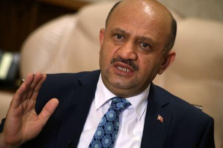 Turkey's Defence Minister Fikri Isik answers a question during an interview with Reuters in Ankara
