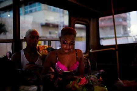 The Wider Image: For Cubans, Wi-Fi means family