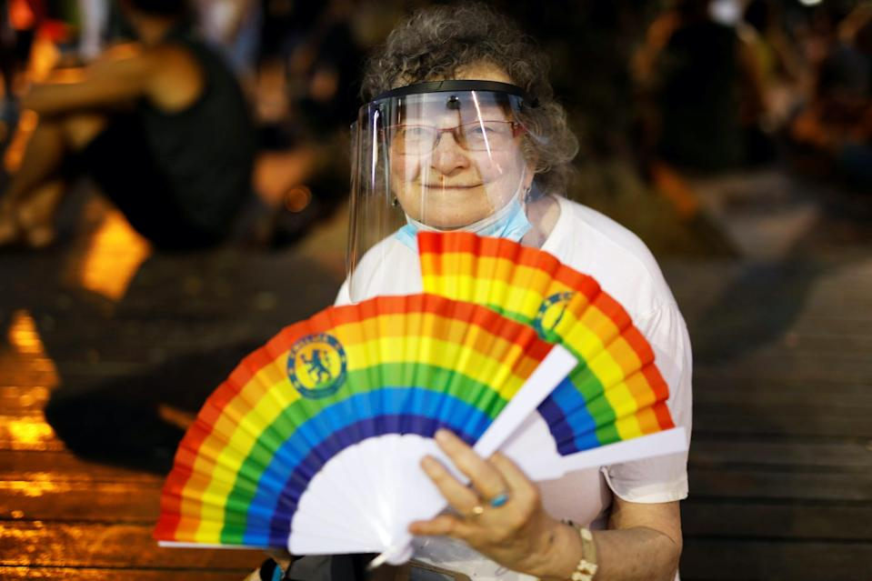 A woman wears face protection as she takes part in a Gay Pride event which has been down-scaled amid coronavirus disease (COVID-19) fears, at Rabin square in Tel Aviv, Israel June 28, 2020