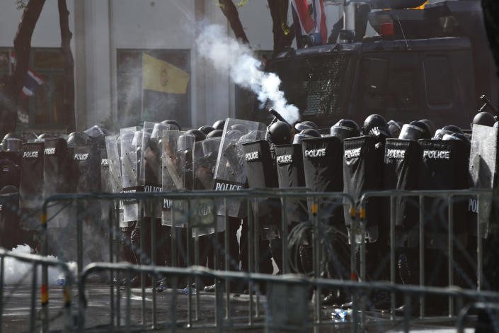 Riot Police launch tear gas to protesters marching to Government House in Bangkok, Thailand Sunday, July 18, 2021. Hundreds of anti-government protesters rallied on Sunday despite the government's recent measures to prohibit the gathering of more than 5 people in the capital to curb the COVID-19 pandemic. Protesters demanded the resignation of Prime Minister Prayuth Chan-ocha and his cabinet.(AP Photo/Anuthep Cheysakron)